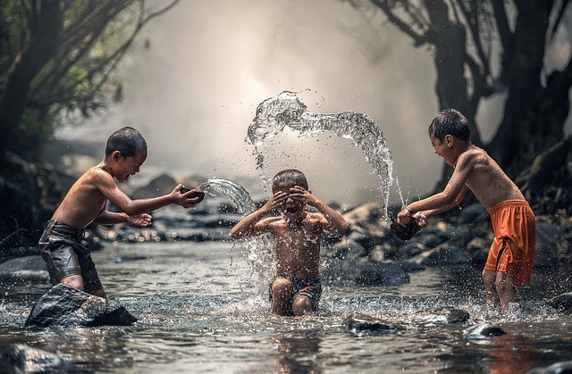 children-river-playing
